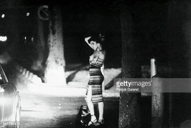 A prostitute bares her body in the glare of car headlamps With prostitution rising at an alarming rate in the Bois de Boulogne a forest come brothel...