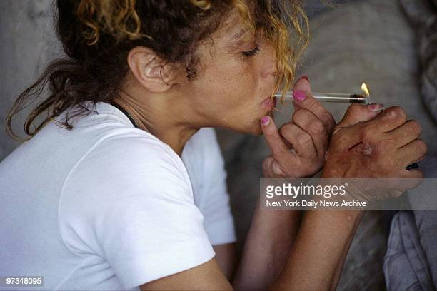 Prostitute Gloria Colon smokes crack after shooting up heroin which helps her to function