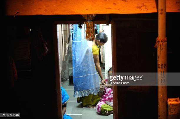 Prostitute in chawl, Kamathipura, Bombay Mumbai, Maharashtra, India