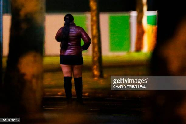 Prostitute stands in a street in Caen, northwestern France, on the night of November 29, 2017 . / AFP PHOTO / CHARLY TRIBALLEAU