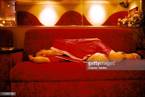 A prostitute taking a nap in the parlor Business at the ranch can be slow at times at the Moonlite Bunny Ranch a legal brothel owned by Dennis Hof in...