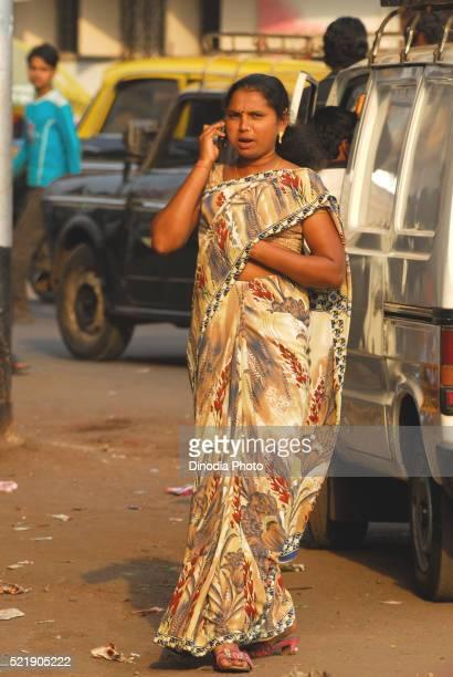 Prostitute talking on mobile, Kamathipura, Bombay Mumbai, Maharashtra, India