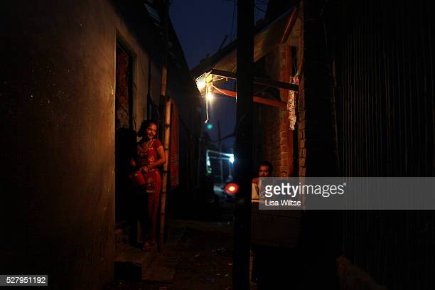 A prostitute waiting for a customer in a dark alleyway in the country's largest brothel in Daulatdia Bangladesh on the banks of the Padma River...