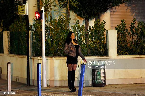 A prostitute waits for a client in a street of the French southeastern city of Nice on March 28 2013 France's Senate will examine today a draft law...