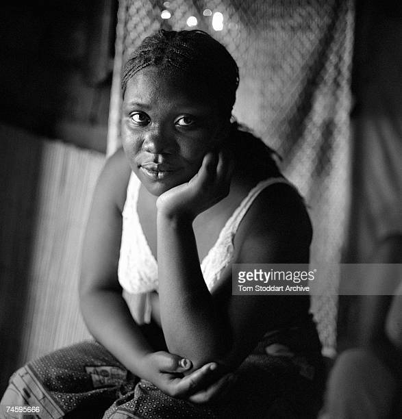 A prostitute waits for clients at her home in Freedom Compound near Lusaka Zambia June 2003