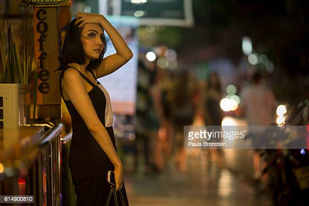 Prostitute wears black in memory of the late King of Thailand on October 15, 2016 in Bangkok, Thailand. The country is grieving the death of their...