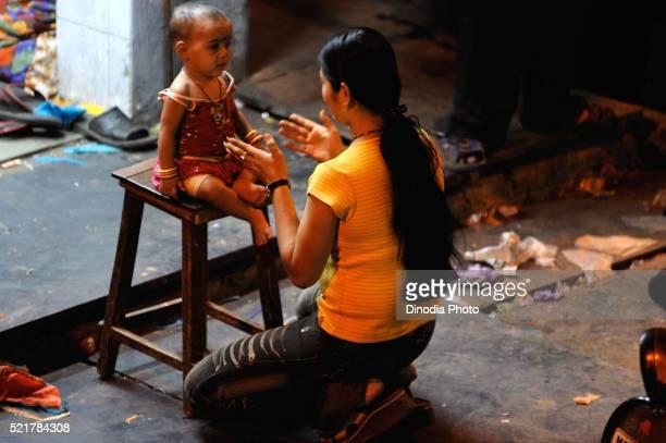 Prostitute with child in Kamathipura, Bombay Mumbai, Maharashtra, India