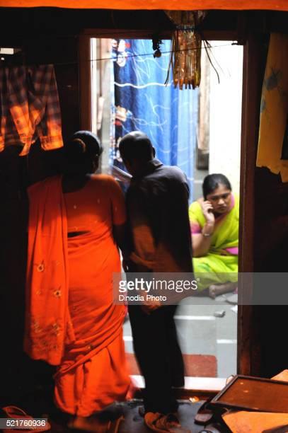 Prostitute with customer in kamathipura, Bombay Mumbai, Maharashtra, India