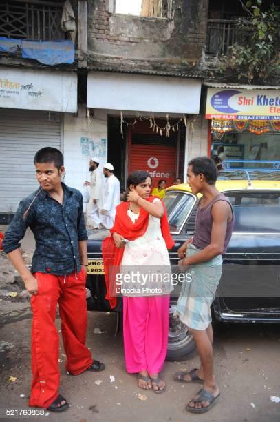 Prostitute with customers in kamathipura, Bombay Mumbai, Maharashtra, India