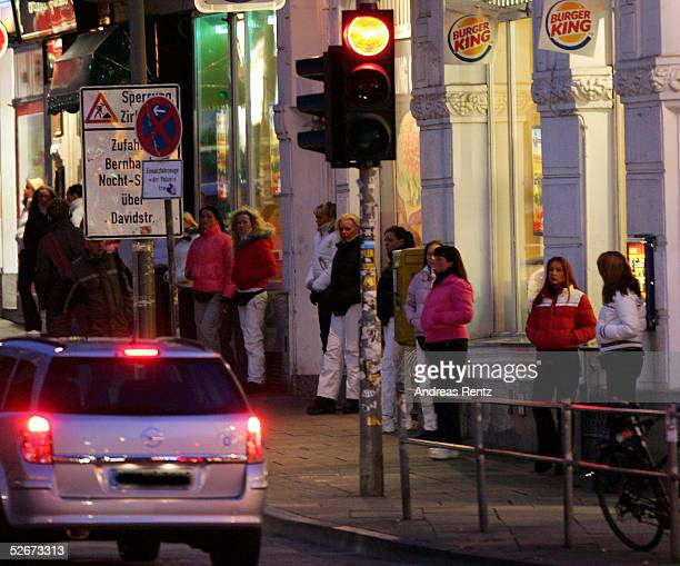 Prostitutes are seen April 20 2005 on the Reeperbahn in St Pauli's Red Light district in Hamburg Germany Prostitution in Hamburg is being used as an...
