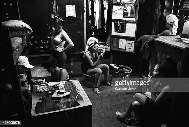 Prostitutes do their makeup in the late afternoon from their basic living quarters on the second floor of the brothel Most of the girls spend hours...