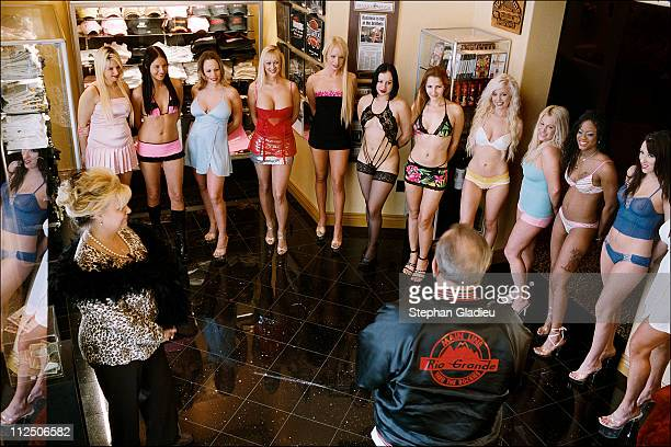 Prostitutes line up for a client who is standing with manager Madame Suzette at the Moonlite Bunny Ranch a legal brothel owned by Dennis Hof in Lyon...