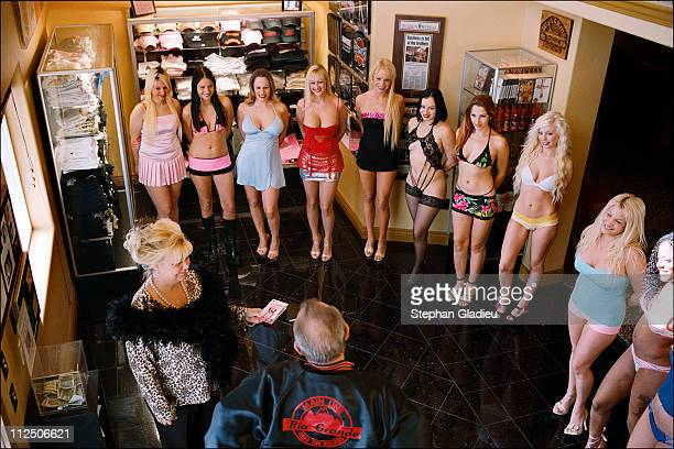 Prostitutes line up for a client who is standing with manager Madame Suzette at the Moonlite Bunny Ranch, a legal brothel owned by Dennis Hof, in...