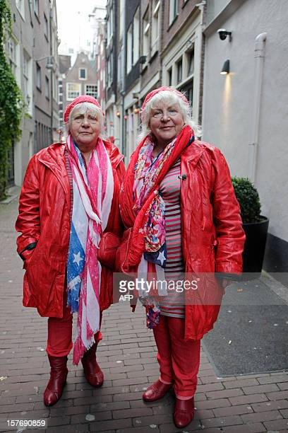 Prostitutes Martine and Louise Fokkens walk around the redlightdistrict of Amsterdam on November 15 the Netherlands Twins Martine and Louise Fokkens...