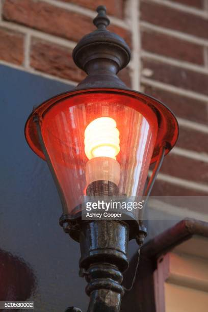 A prostitutes red light at a brothel in the Amsterdam red light district