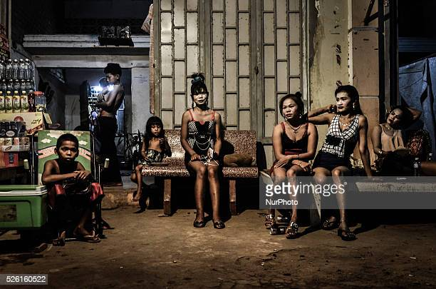 Prostitutes sit outside of a brothel on the outskirts of Siem Reap city Cambodia on April 26 2015 UNICEF estimates that children account for a third...