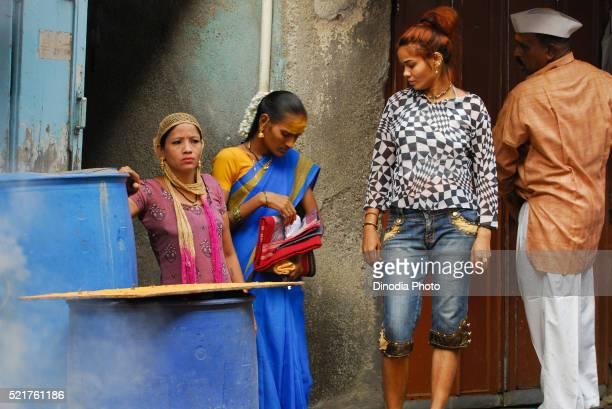 Prostitutes standing in Kamathipura, Bombay Mumbai, Maharashtra, India
