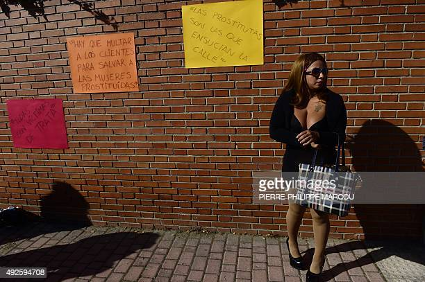 A prostitutes stands beside hand written signs stuck on a wall during a protest performance called by AFEMTRAS a womens network of sex workers to...