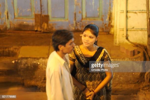 Prostitutes talking to man in kamathipura, Bombay Mumbai, Maharashtra, India