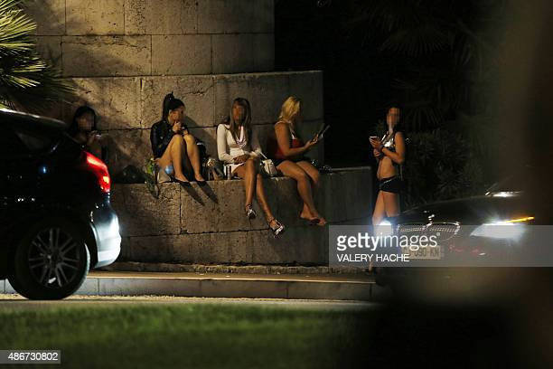 Prostitutes wait for clients in a street of the French southeastern city of Nice, on September 5, 2015. AFP PHOTO / VALERY HACHE