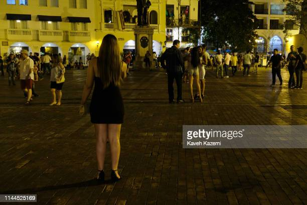 CARTAGENA of INDIAS COLOMBIA FEBRUARY 2 2019 Prostitutes wait for foreign tourists in Puerta del Reloj at night on February 2 2019 in Cartagena...