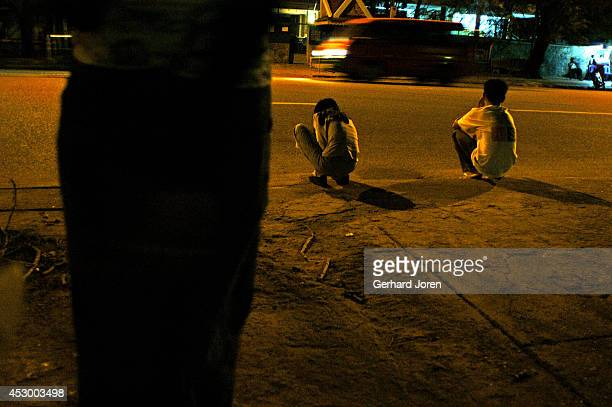Prostitutes waiting for customers by the side of the road