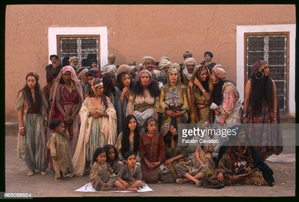 Prostitutes with kids customers and elderly people stand in front a building during the shooting of the movie Un The au Sahara or Il Te Nel Deserto...