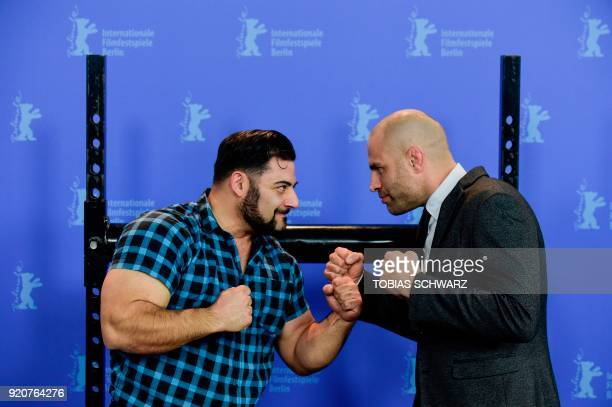 TOPSHOT Protagonist German strongman competitor strength athlete and former bodybuilder Patrik Baboumian poses with protagonist retired English...