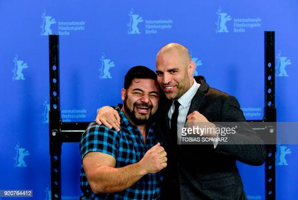 Protagonist German strongman competitor strength athlete and former bodybuilder Patrik Baboumian poses with protagonist retired English professional...
