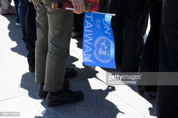 A proTaiwan protester holds a flag during a demonstration outside of the United Nations offices on the opening day of the World Health Assembly the...