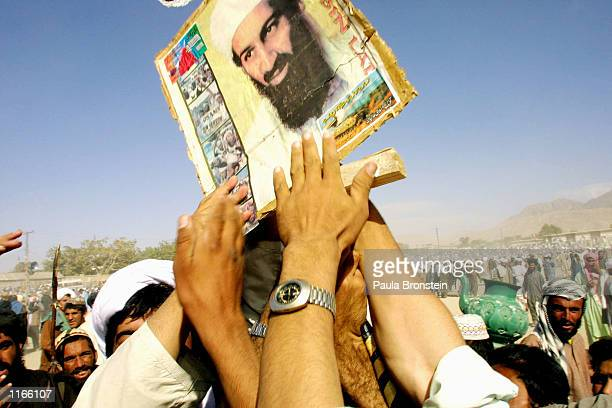 ProTaliban supporters hold up a poster of Osama bin Laden during a rally October 1 2001 in the town of Quetta Pakistan Quetta is located near the...