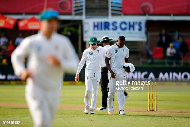 Proteas captain Faf du Plessis congratulates South Africa bowler Lungi Ngidi after taking the wicket of during day one of the second Sunfoil Test...