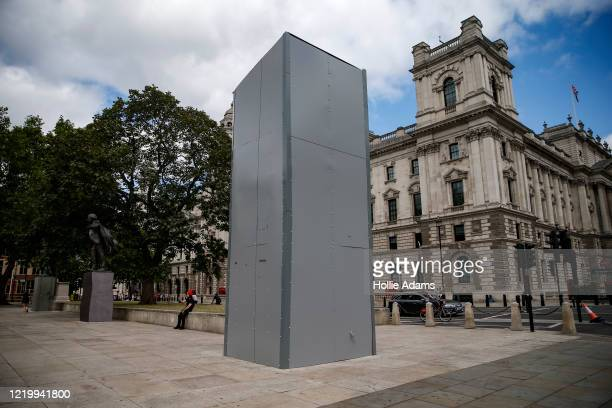 A protected statue of Sir Winston Churchill in Parliament Square on June 14 2020 in London England Several statues and monuments were protected with...