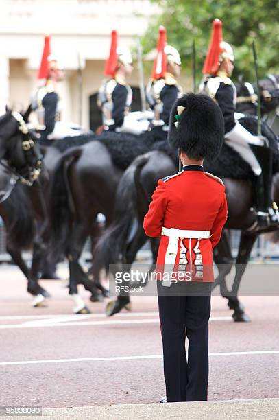 protecting her majesty during trooping the colour, london - buckingham palace stock pictures, royalty-free photos & images