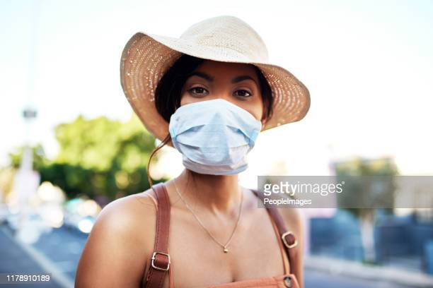 protecting myself from all the polluted air in the city - africa stock pictures, royalty-free photos & images