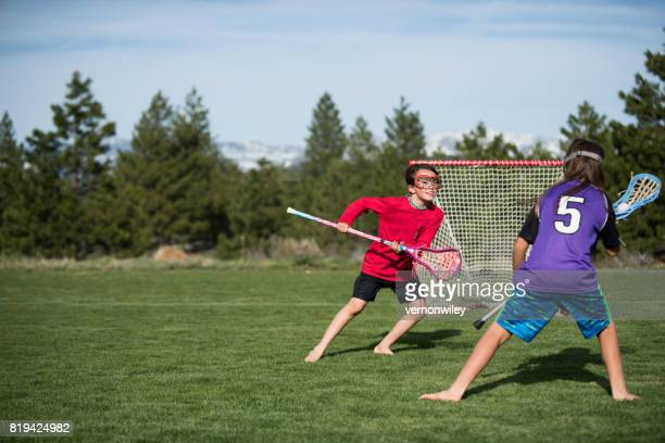 protecting the goal - lacrosse stock pictures, royalty-free photos & images