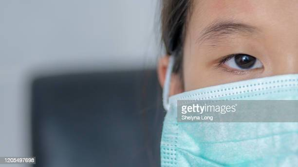 protection against flu viruses - coronavirus mask stock pictures, royalty-free photos & images