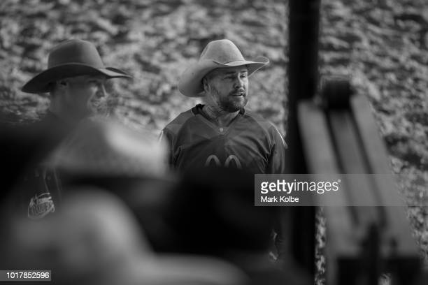 Protection athletes Brody Moss and Lincoln Brown watch the chute as a rider prepares to exit the gate during the Bull Ride competition of the 2018...