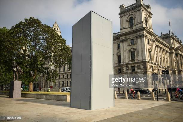 A protective barrier is seen around the statue of Winston Churchill in Parliament Square in anticipation of protests today on June 12 2020 in London...