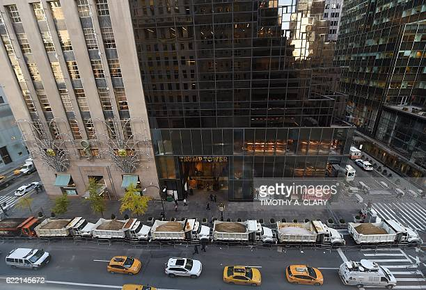 TOPSHOT A protective barrier of Sanitation Department trucks are parked in front of Trump Tower on 5th Avenue to provide security to US...