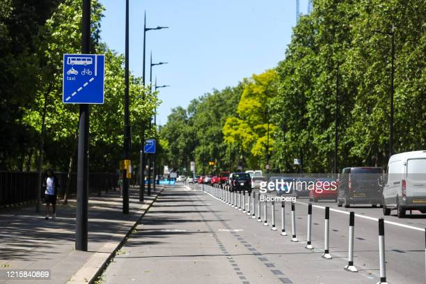 Protective barriers stand on the edge of a new bicycle lane created by Transport for London on Park Lane in London, U.K., on Thursday, May 28, 2020....