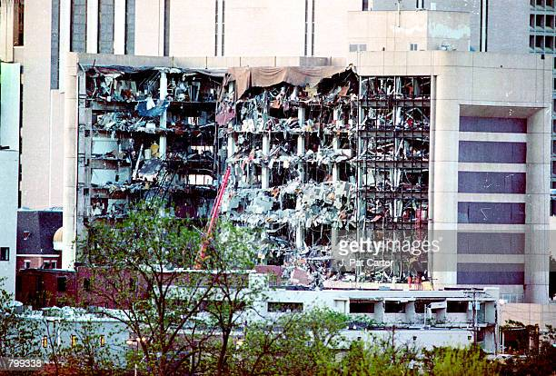 Protective covering drapes over part of the Alfred P Murrah Federal Building in Oklahoma City April 19 1995 where a terrorist bomb killed 168 people...