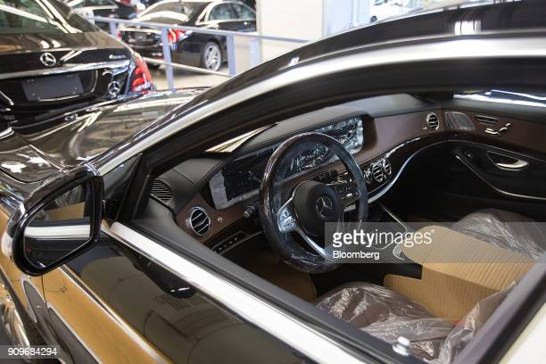Protective covers sit on the interior of a MercedesBenz Maybach luxury automobile on the final quality check line at the automaker's factory in...