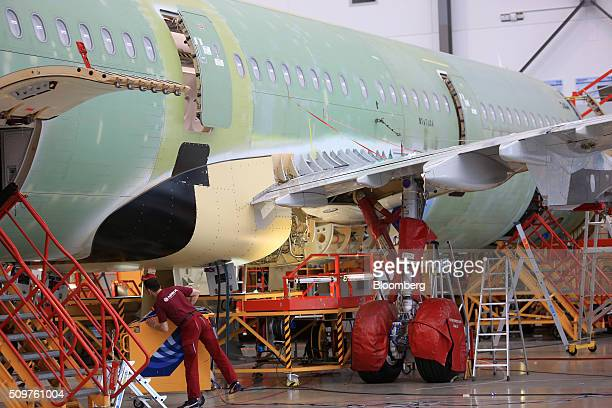 Protective covers sit on the landing gear of an Airbus A320 aircraft on the final assembly line inside the Airbus Group SE factory in Hamburg Germany...