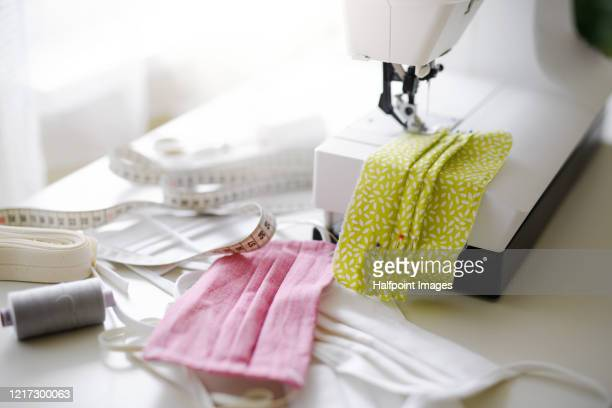 protective face mask sewing indoors at home, quarantine concept. - homemade stock pictures, royalty-free photos & images