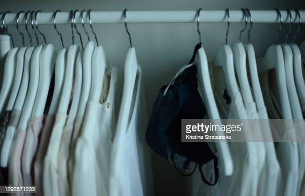 protective face masks hanging along with white blouses - white shirt stock pictures, royalty-free photos & images
