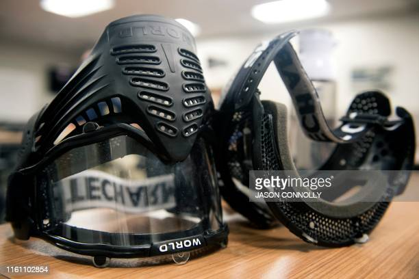 Protective face masks that school teachers and administrators will wear during an Airsoft active shooter drill sit on a table during the FASTER Level...