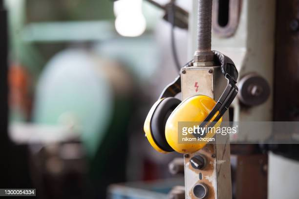 protective headphones construction tool. protective headphones. professional construction accessory - hearing protection stock pictures, royalty-free photos & images