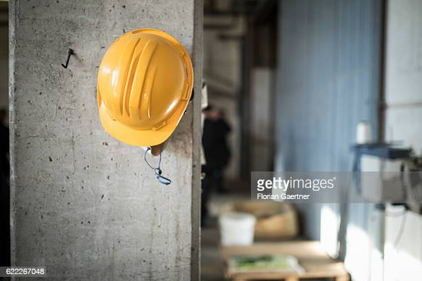 A protective helmet hangs on a column on a construction site on November 04 2016 in Nafplion Greece