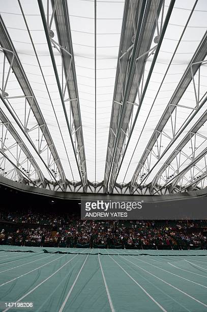 Protective rain covers on the Center Court grass as the roof is closed on day three of the 2012 Wimbledon Championships tennis tournament at the All...